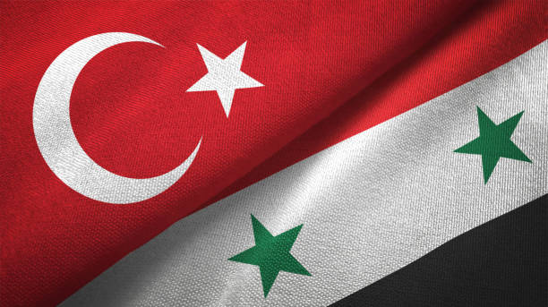Syria and Turkey two flags together textile cloth fabric texture Syria and Turkey flag together realtions textile cloth fabric texture turkish stock pictures, royalty-free photos & images