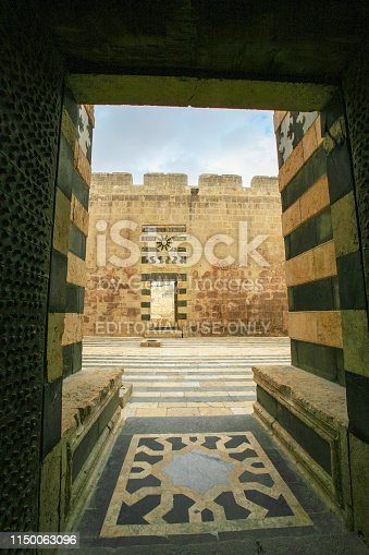 istock Syria before the war. Floor mosaic and wall of the impressive medieval Citadel of Aleppo. 1150063096