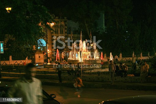 695022520 istock photo Syria before the war. People in a public square and fountain in Hama by night. 1145099421