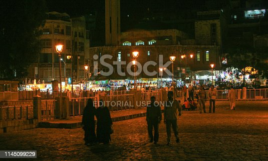 695022520 istock photo Syria before the war. People in a public square in Hama by night. 1145099229