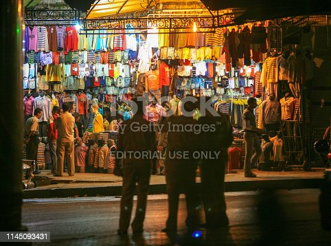 695022520 istock photo Syria before the war. People in Hama market by night. 1145093431