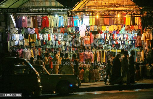 695022520 istock photo Syria before the war. People in Hama market by night. 1145099166