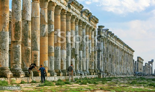 istock Syria before the war. People visiting the Great Colonnade in the impressive Apamea Greek and Roman city of Apamea in Syria. 1145836300