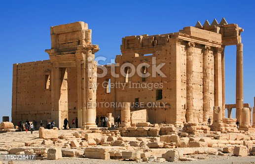 695022520 istock photo Syria before the war. People visiting the impressive Roman remains of Palmyra, before is destruction, in Syria. 1150738417