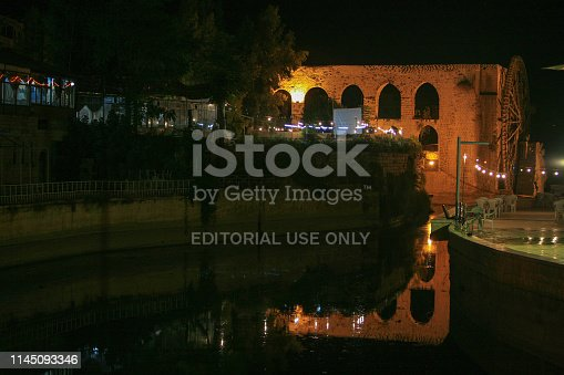 695022520 istock photo Syria before the war. The wooden giant water wheels of Hama by night. 1145093346