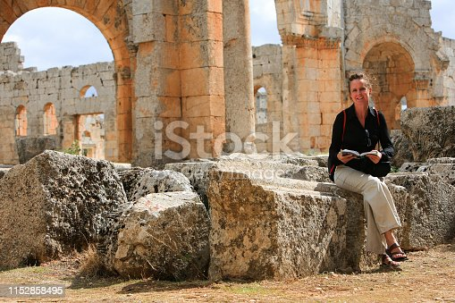 695022520 istock photo Syria before the war. Woman traveler visiting the remains of the Byzantine church of Saint Simeon Stylites in Qalaat Semaan, one of the Dead Cities near Aleppo, in northern Syria. 1152858495