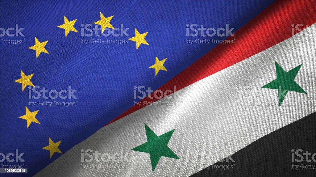 Siria Siria y la Unión Europea dos banderas juntos relaciones textil tela textura de la tela - foto de stock