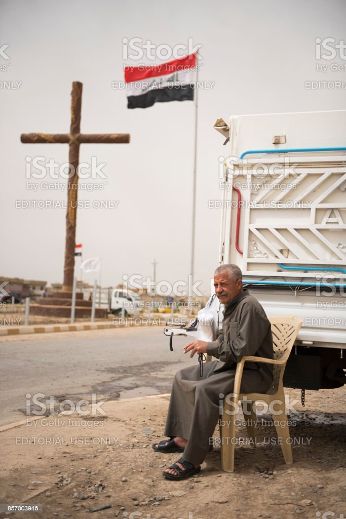 Syriac Christian selling ice in Qaraqosh, Iraq stock photo