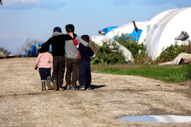 syrian children hugging in the camp - poverty stock pictures, royalty-free photos & images