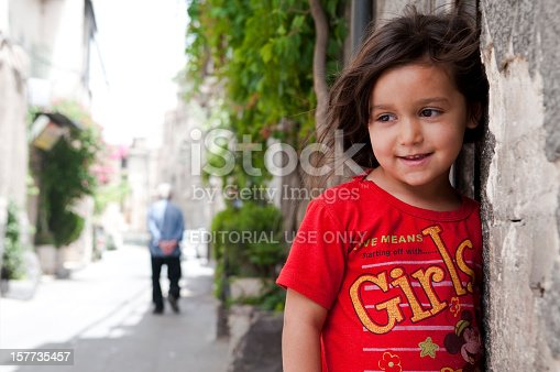 A Syrian girl stands outside a home in Damascus, Syria in 2010.