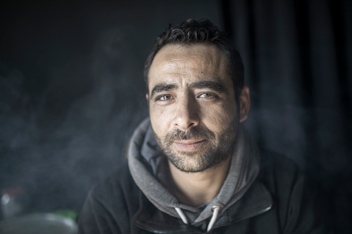 Portrait of middle eastern refugee