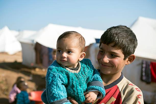 Syrian refugees at displaced persons camp picture id458268493?b=1&k=6&m=458268493&s=612x612&w=0&h=ugj9nzjybpa2awja6ibvjmlaxcyojtbc6rwikpgaq8i=