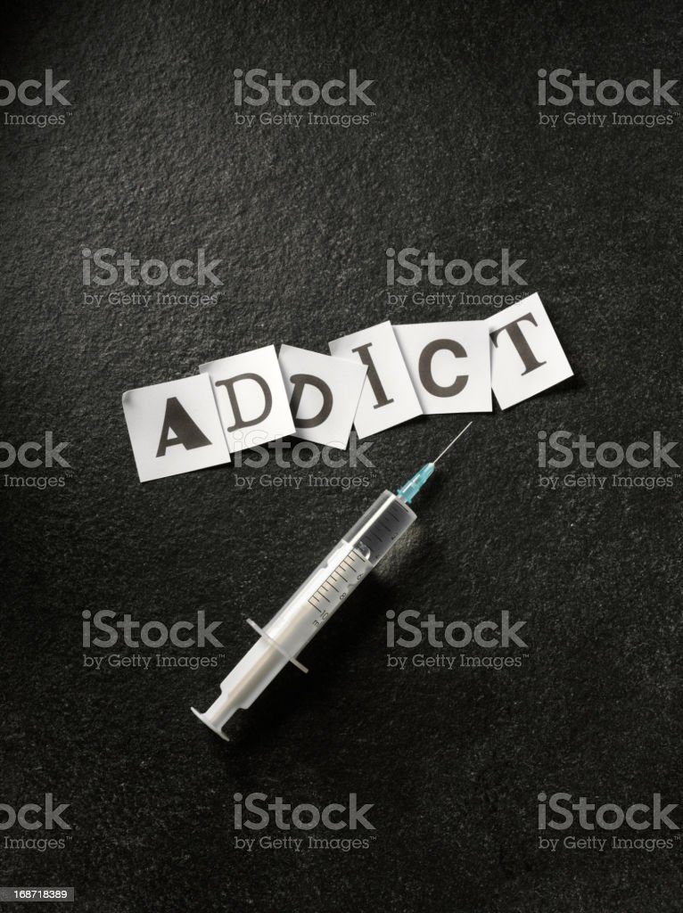 Syringe and Addict stock photo
