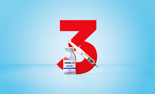 Syringe and COVID-19 vaccine bottle sitting next to a huge red number three on blue background, Horizontal composition with copy space. Great use for concepts related to efficacy of COVID-19 vaccines.