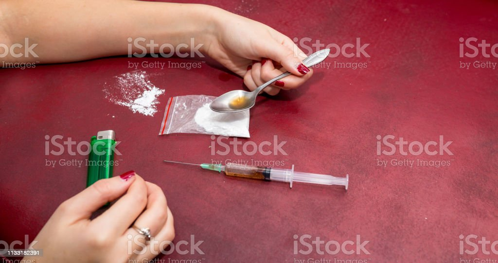 Syringe And Heroin On Spoon Drug Addiction Stock Photo
