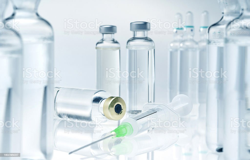 Syringe and medicine stock photo