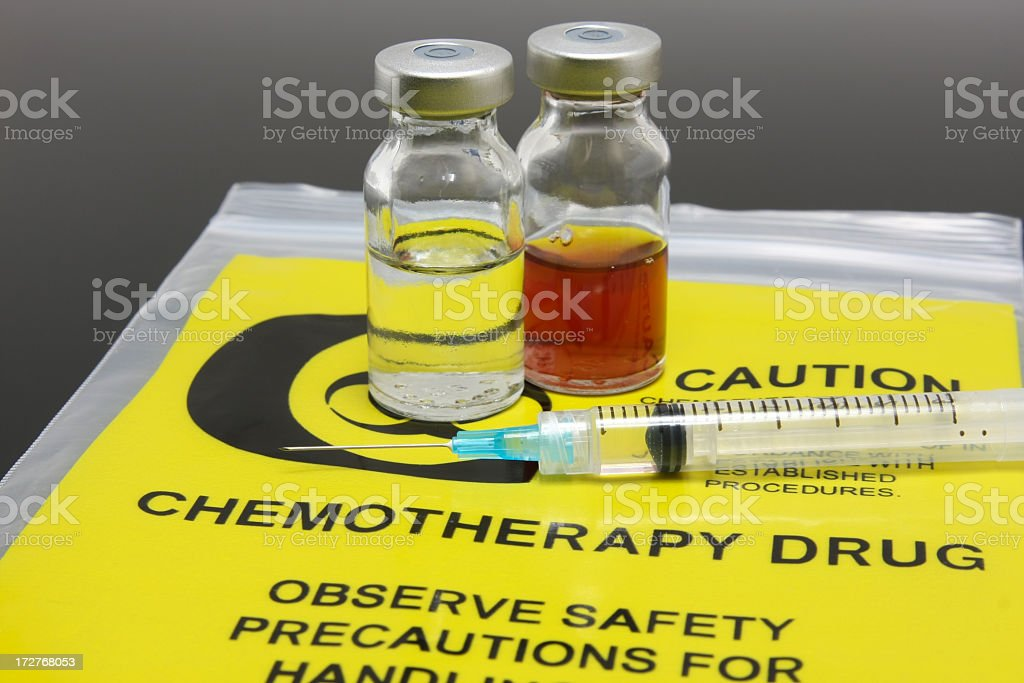 A syringe and two vials of chemotherapy drugs stock photo