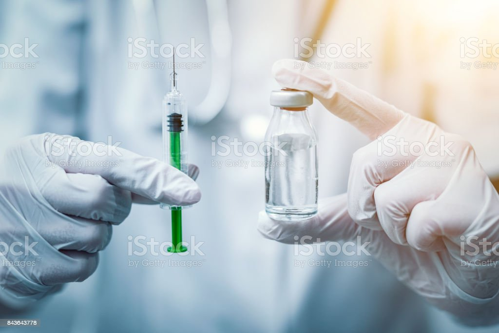 Syringe, medical injection in hand. Vaccination equipment. stock photo