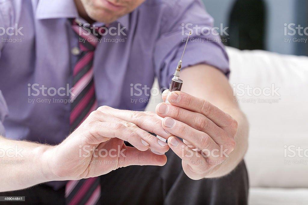 Syringe of illicit drugs stock photo