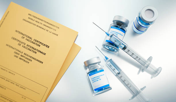 Syringe, vial and international certificate of vaccination stock photo