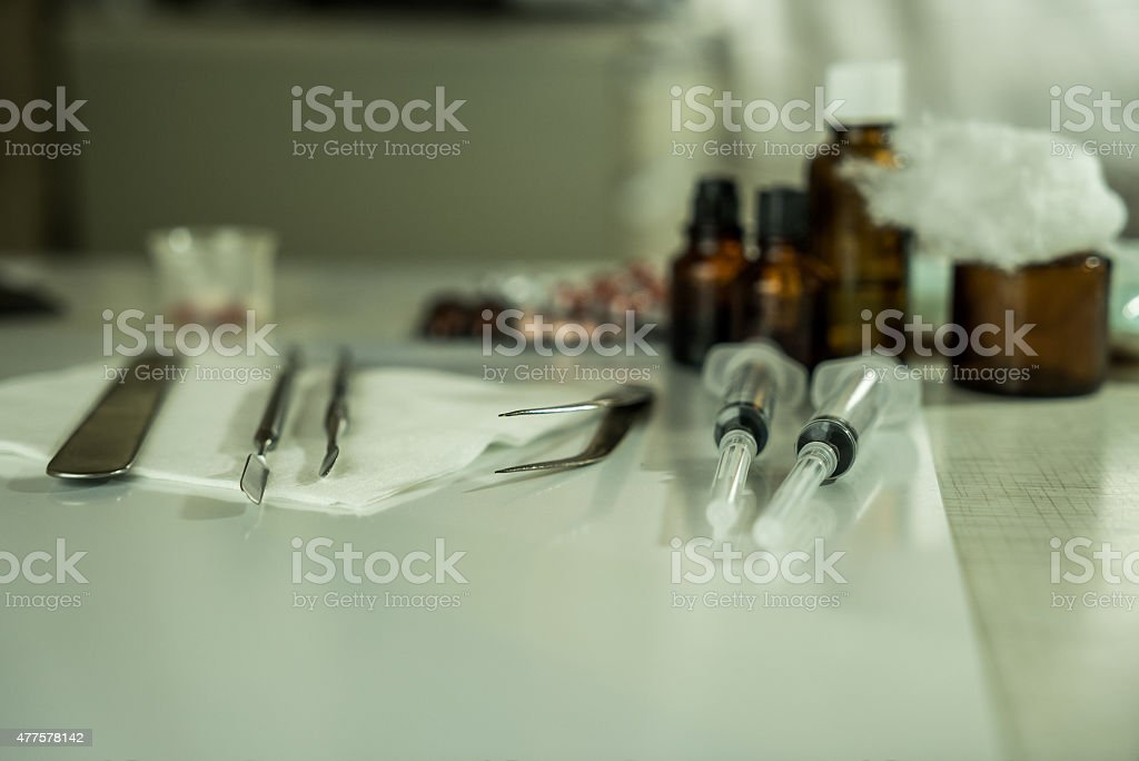 Syringe with glass vials and medications pills drug stock photo