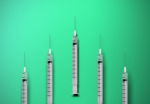 Syringes, competition, casting shadow stock photo