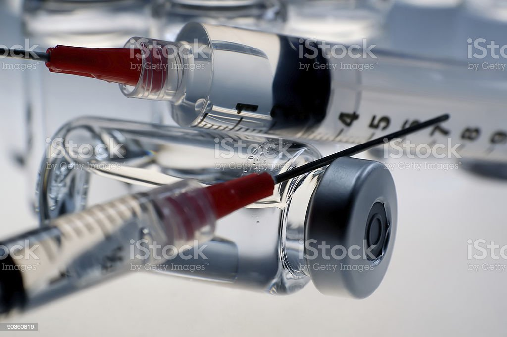 Syringes on a bottle stock photo