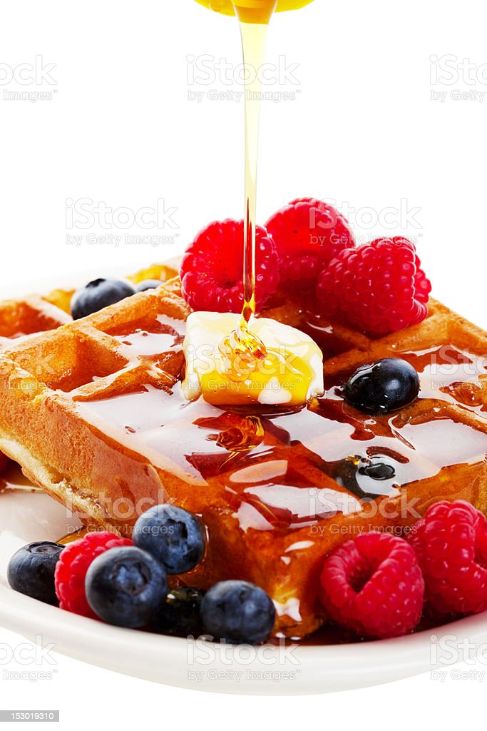 Syrup Pouring Over Waffles royalty-free stock photo