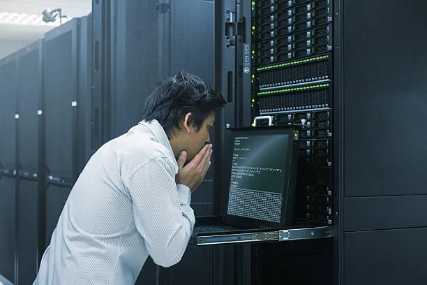 system administrator finish working in data center - error stock-fotos und bilder