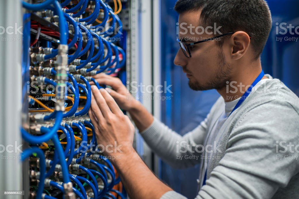 System Engineer Checking Servers stock photo