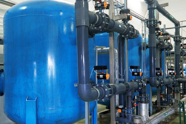 System of water treatment Modern complex of cleaning, disinfecting and preparation of drinking water sewage treatment plant stock pictures, royalty-free photos & images