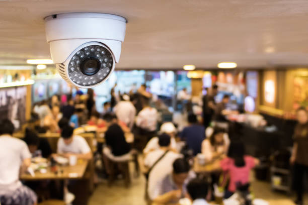 CCTV system security inside of restaurant.Surveillance camera installed on ceiling to monitor for protection customer in restaurant CCTV system security inside of restaurant.Surveillance camera installed on ceiling to monitor for protection customer in restaurant security staff stock pictures, royalty-free photos & images