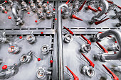 istock A system with a lot of ball valves. Ball valves are mounted on a wall made of stainless steel 845953132