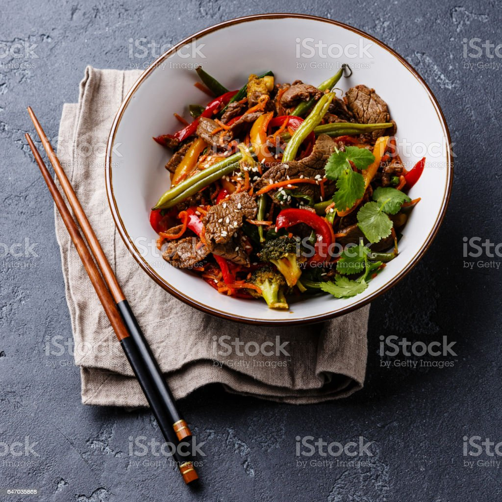 Szechuan beef stir-fried with vegetables in bowl stock photo
