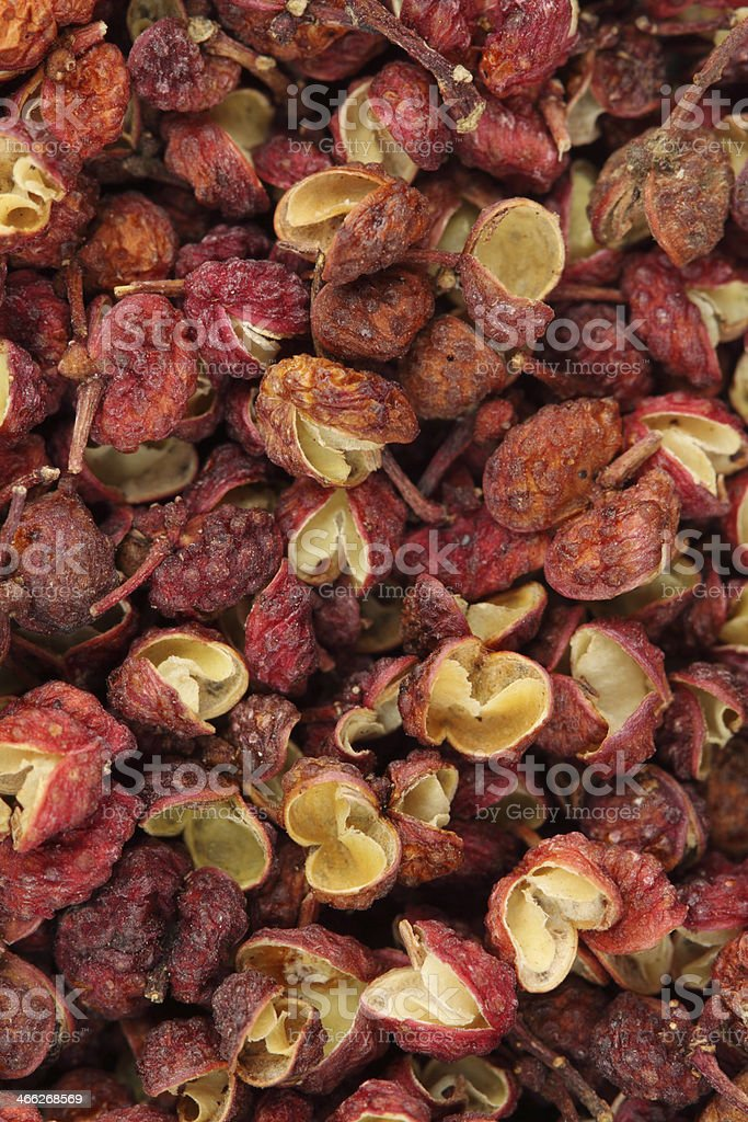 Szechuan peppercorns background stock photo