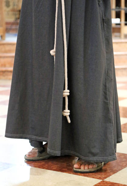 t friar with sandals and brown habit franciscan friar with sandals and brown habit in the church friar stock pictures, royalty-free photos & images