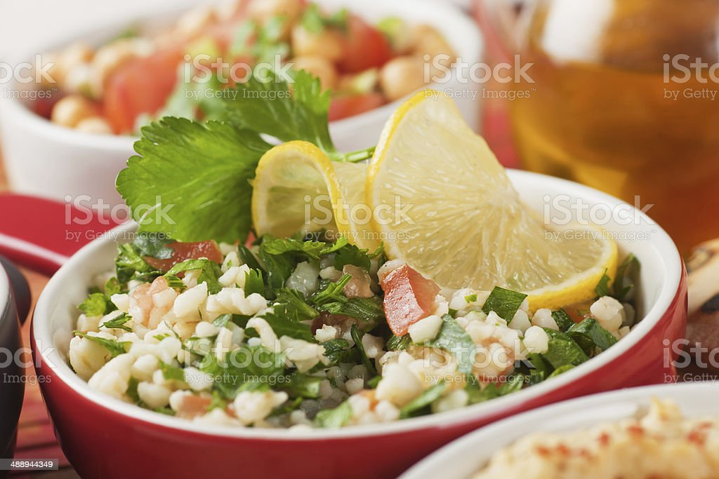 Tabbouleh, bulgur wheat salad stock photo
