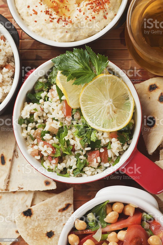 Tabbouleh, middle east salad with bulgur pasta stock photo