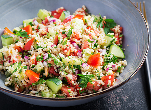 Tabbouleh salad. Traditional middle eastern or arab dish. Levantine vegetarian salad with parsley, mint, bulgur, tomato.