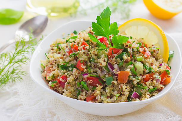 tabbouleh salad with quinoa, parsley and vegetables - quinoa stock photos and pictures