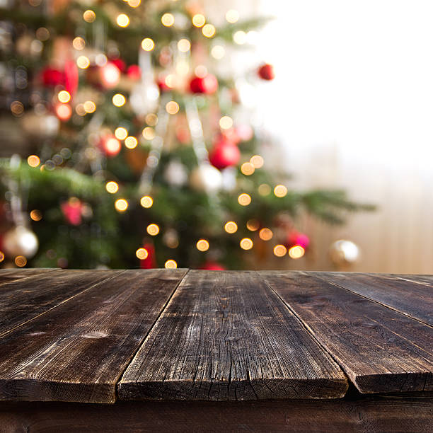 table against christmas tree stock photo - Table Christmas Tree