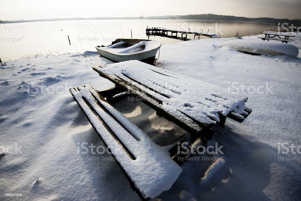 Table and bench covered in snow royalty-free stock photo