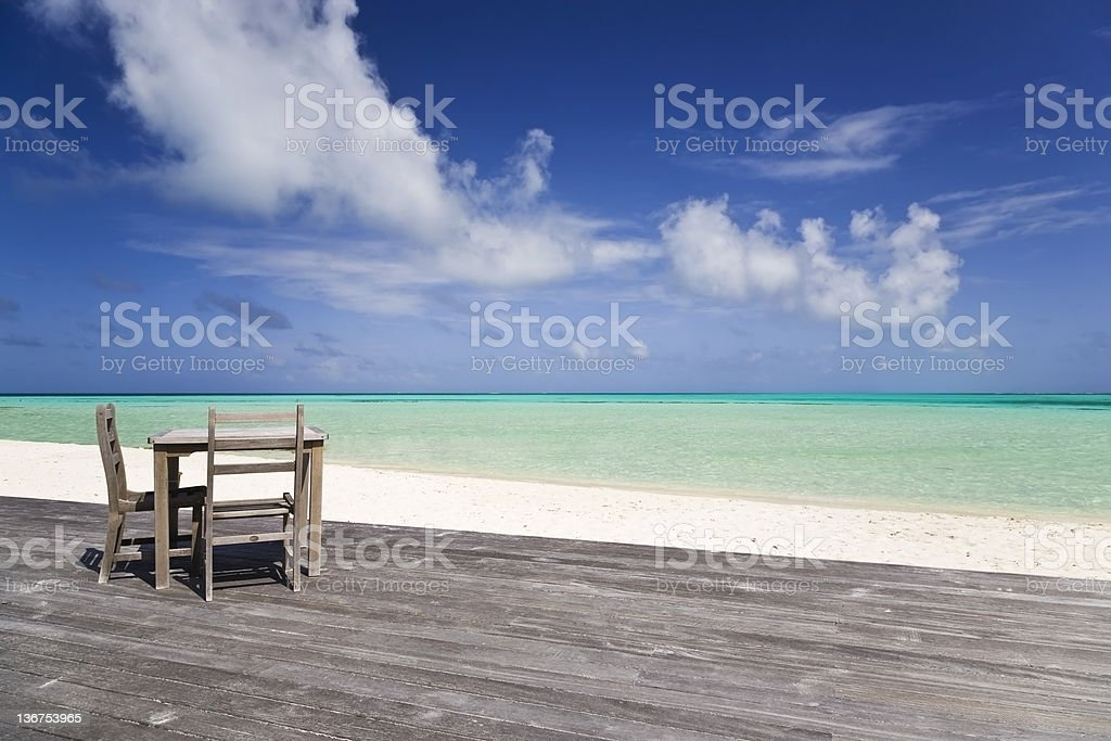 Table and chairs at paradise beach royalty-free stock photo