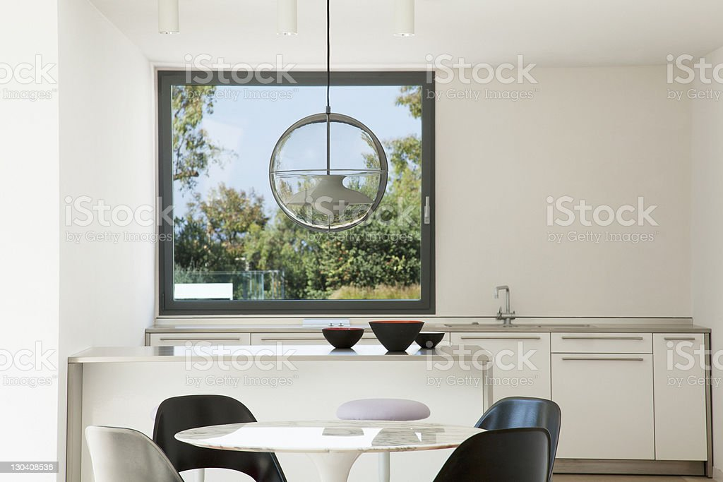 Table and chairs in modern kitchen royalty-free stock photo