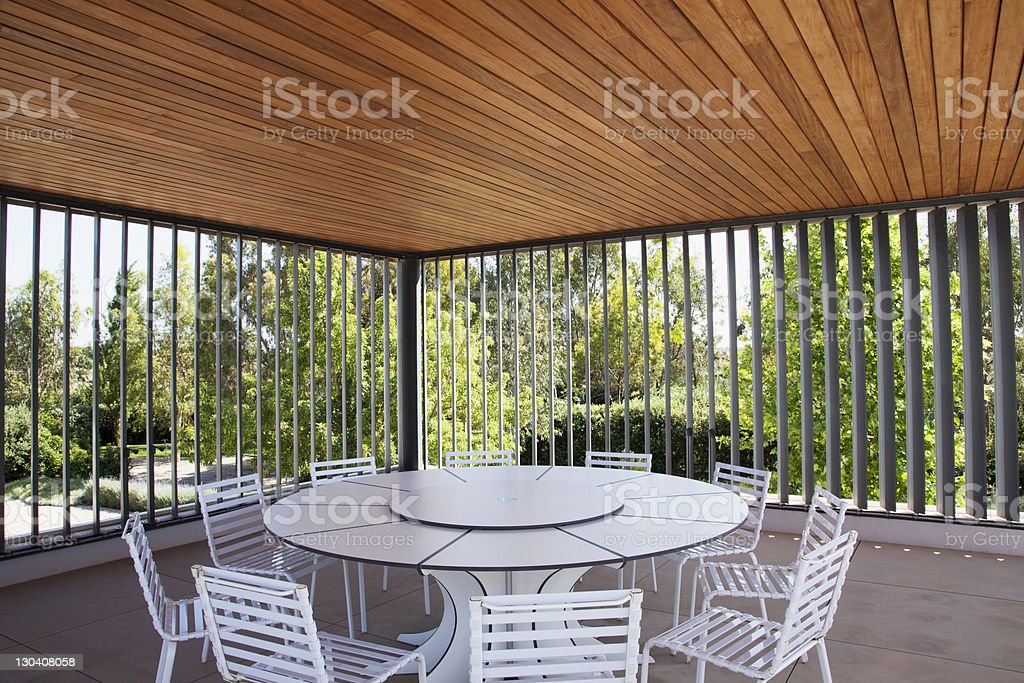 Table and chairs in modern outdoor space royalty-free stock photo