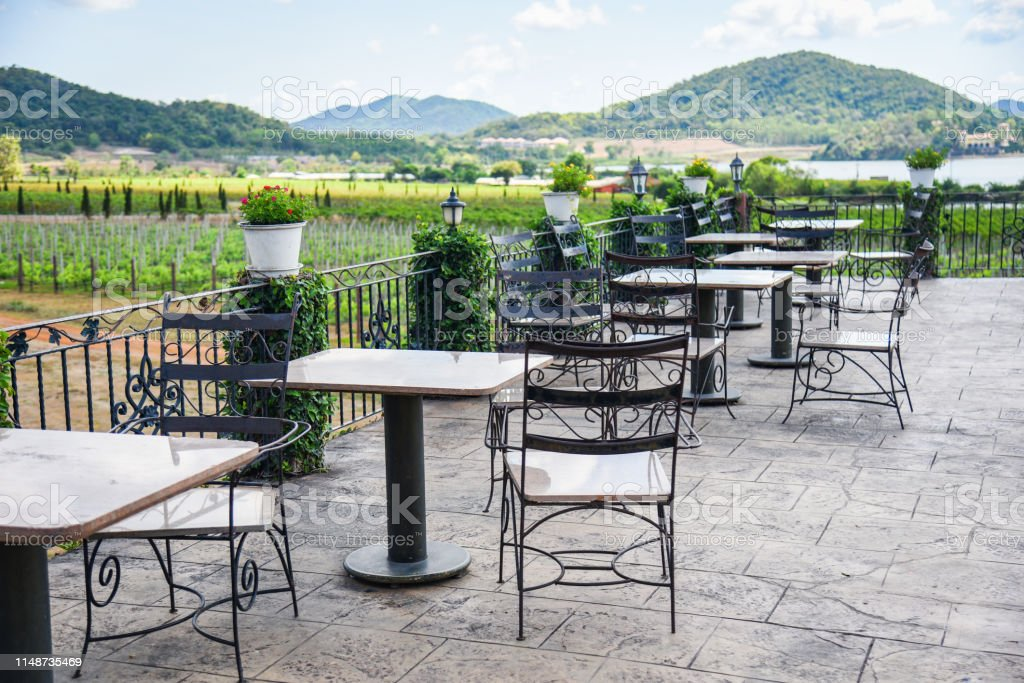 Table And Chairs In The Balcony Of Outdoor Restaurant View Nature Farm And Mountain Background Dining Table On The Terrace Stock Photo Download Image Now Istock