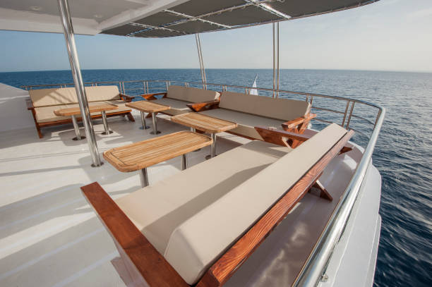 Table and chairs on deck of a luxury motor yacht stock photo