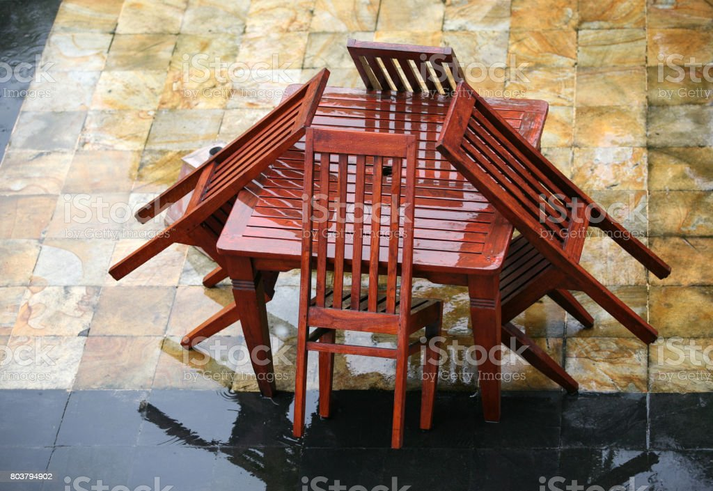 Table and chairs wet from a rain stock photo