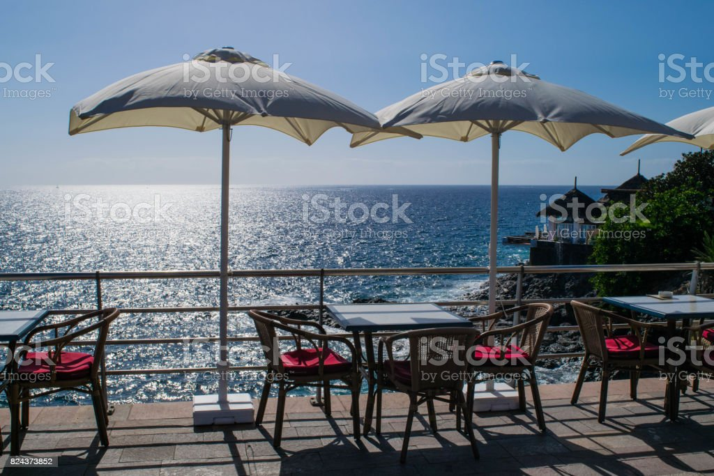 Table and chairs with umbrella and a beautiful sea view, Tenerife, Costa Adeje, canary islands, Spain stock photo