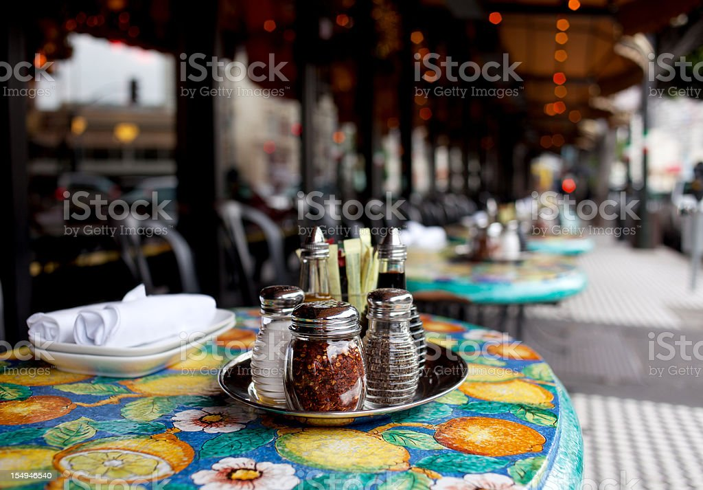 Table at sidewalk cafe stock photo